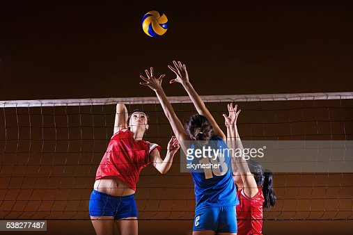 Female volleyball team practicing.