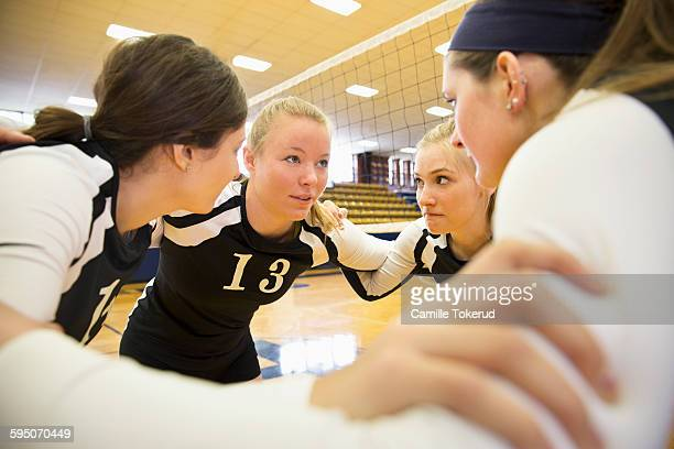 Female Volleyball teammates talking