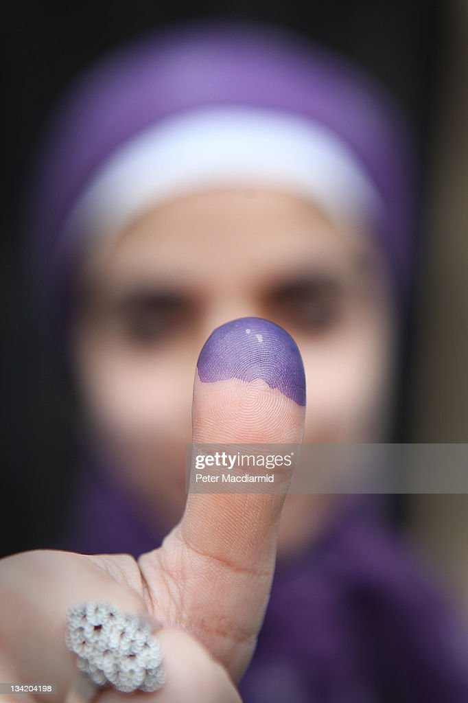 A female voter shows her inked finger after voting at a polling station in a girls school on November 28, 2011 in Downtown Cairo, Egypt. Eleven months after the fall of Hosni Mubarak 45 million Egyptians are voting in the first round of six for it's upper and lower houses of parliament. The complicated process will take four months to conclude. Presidential elections are expected to be held in 2012.