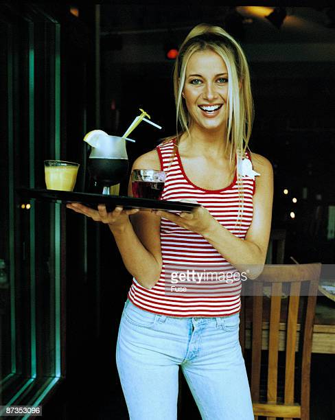 Female waiter holding drinks on tray