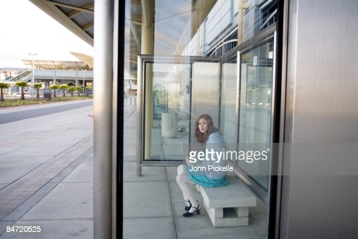 female waiting for bus