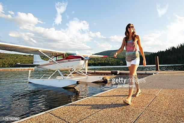 Female walking away from airplane.