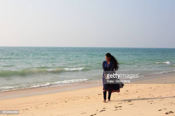 Female Walking in the Seashore