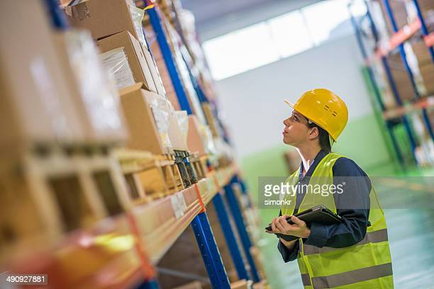 Female Warehouse Employee Doing A Checklist