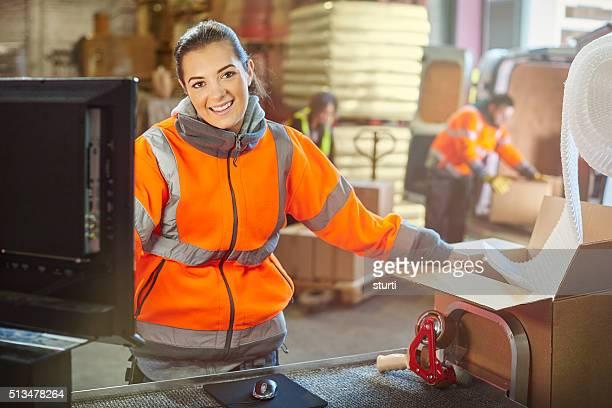 female warehouse packer