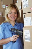 Female warehouse worker with barcode scanner