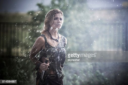 Female warrior at rain.