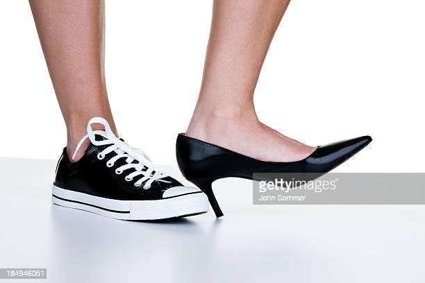 Female wearing a dress shoe and sneaker