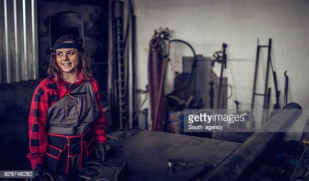 Female welder in workshop