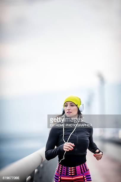 Female with headphones jogging in the winter morning