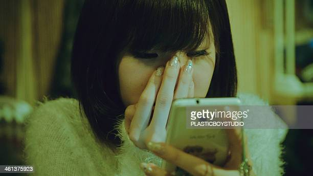 Female with mobile phone