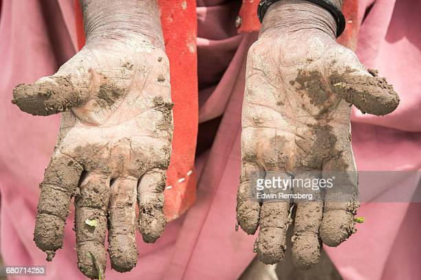 Female with muddy hands
