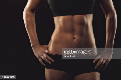 Female with perfect abdomen muscles : Stock Photo