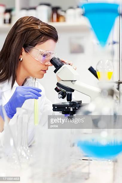 Female Woman Scientist  In Laboratory