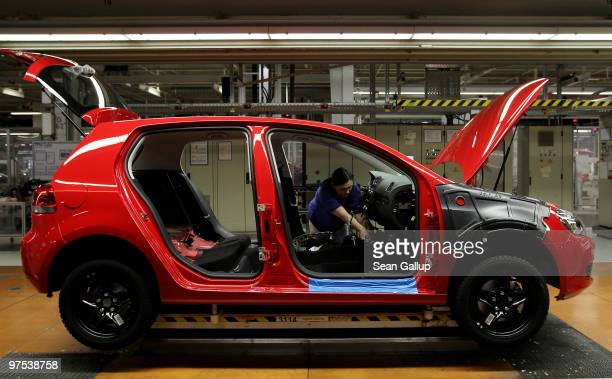 A female worker assembles a Volkswagen Golf VI car on the assembly line at the VW factory on March 8 2010 in Wolfsburg Germany Volkswagen will...
