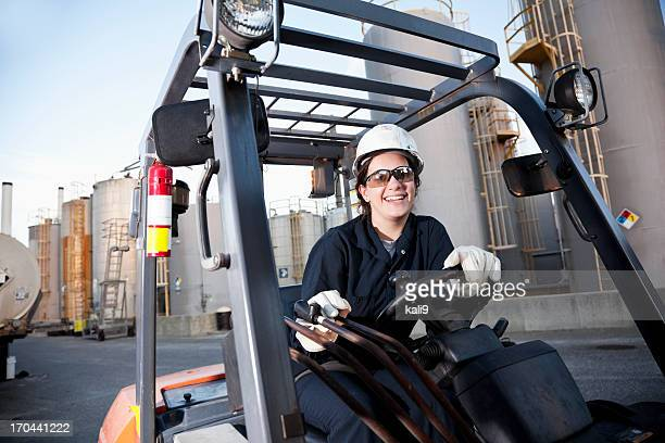 Female worker driving forklift