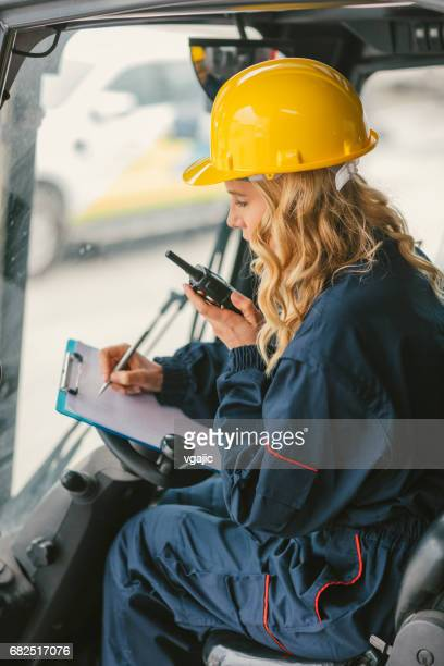 Female worker in forklift