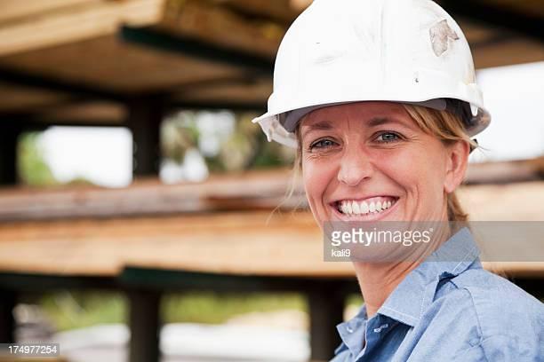 Female worker in lumberyard