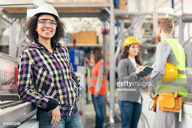 Female worker possing for the camera in the factory