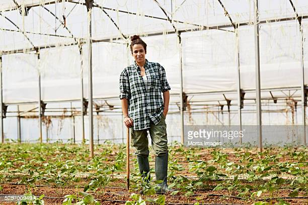 Female worker standing in greenhouse