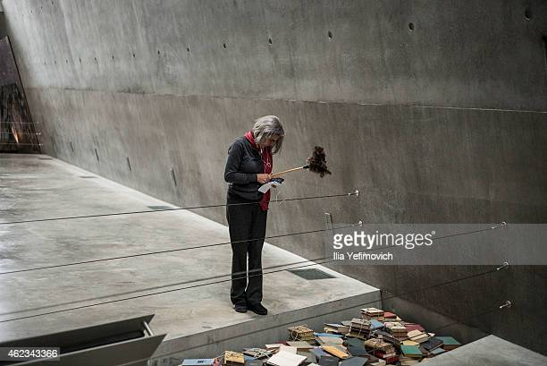 A female worker tends to a display at the Yad Vashem museum exhibition which commemorates International Holocaust day on January 27 2015 in Jerusalem...