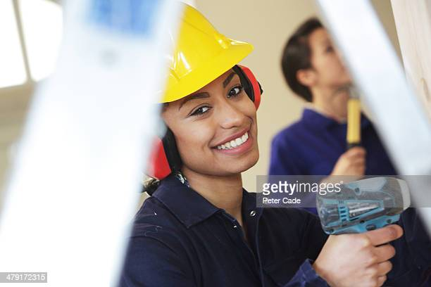 Female worker with drill