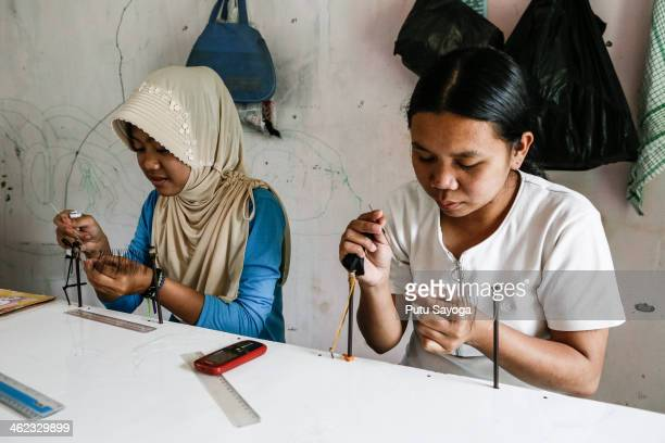 Female workers make false eyelashes on January 13 2014 in Purbalingga Central Java Indonesia The Victoria Albert Museum in London UK has caused a...