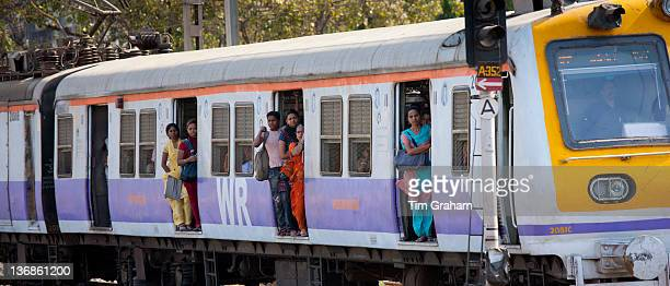 Female workers on crowded commuter train of Western Railway near Mahalaxmi Station on the Mumbai Suburban Railway India