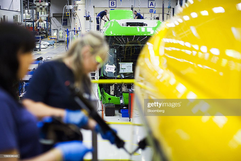 Female workers use machine tools during the assembly of a bus at Volvo AB's manufacturing plant in Wroclaw, Poland, on Friday, Jan. 11, 2013. Volvo plans to end bus making in Saeffle by June 2013, and will consolidate the business in Europe to its main plant in Wroclaw, Poland, the Gothenburg, Sweden-based company said. Photographer: Bartek Sadowski/Bloomberg via Getty Images