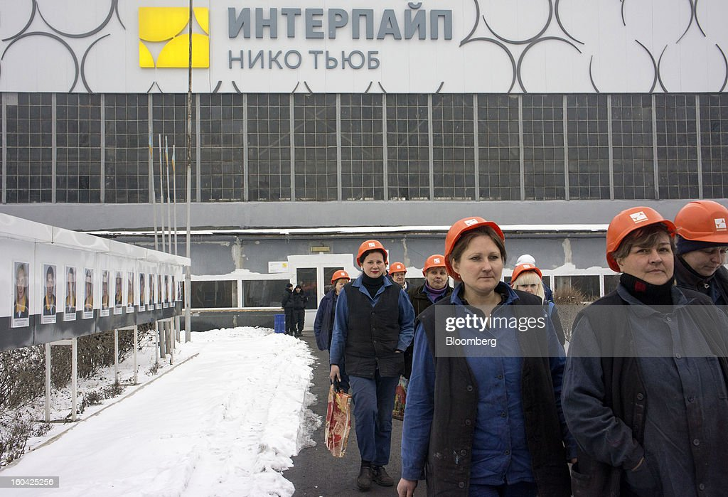 Female workers wear safety helmets as they leave the seamless pipe factory, operated by Interpipe LLC, in Nikopol, Ukraine, on Wednesday, Jan. 30, 2013. Ukraine's Interpipe Group, owned by billionaire Victor Pinchuk, opened a $700 million electric steel mill in Dnipropetrovsk with an annual output capacity of 1.32 million tons of steel for its seamless pipe production. Photographer: Vincent Mundy/Bloomberg via Getty Images