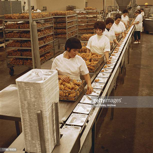 Female workers working at food processing plant
