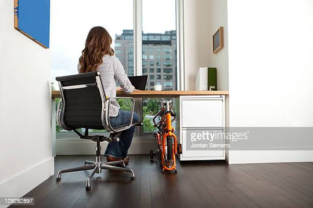 A female working at a home office.