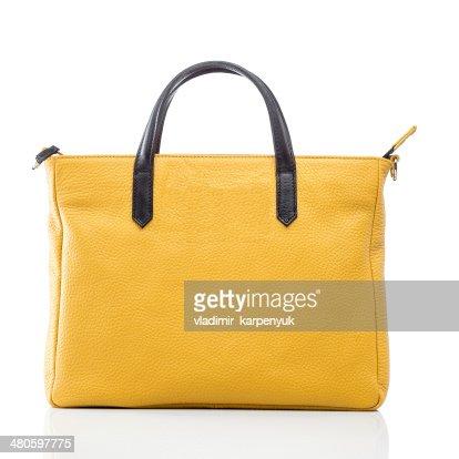 female yellow leather handbag : Stock Photo