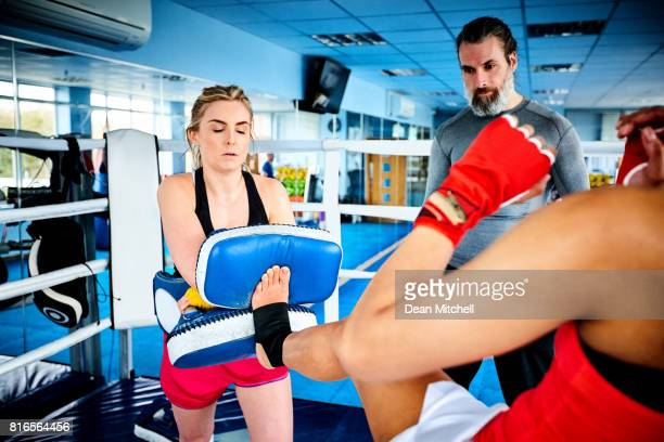 Females doing kickboxing training in fight club