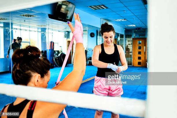 Females getting ready for kickboxing practice in gym