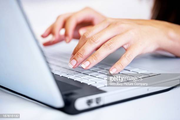 Female's hands working on laptop