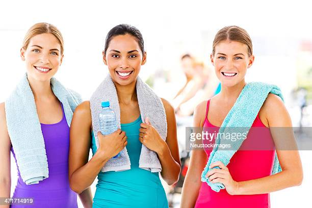 Females With Water Bottle And Towels At Gym