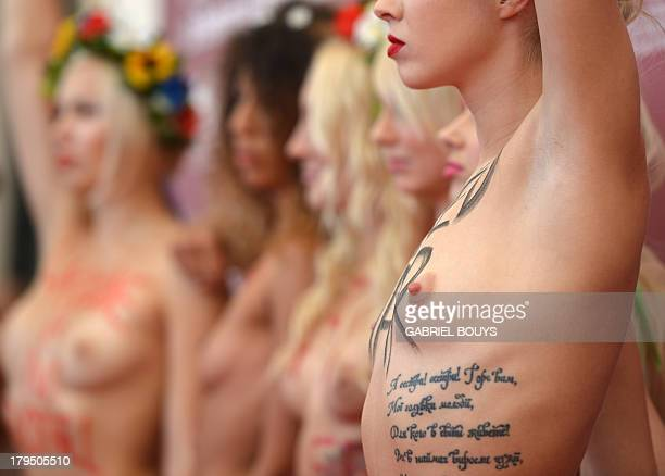 Femen activist pose during the photocall of 'Ukraine is not a Brothel' presented out of competition at the 70th Venice Film Festival on September 4...