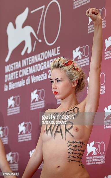 Femen activist Sasha Shevchenko poses during the photocall of 'Ukraine is not a Brothel' presented out of competition at the 70th Venice Film...