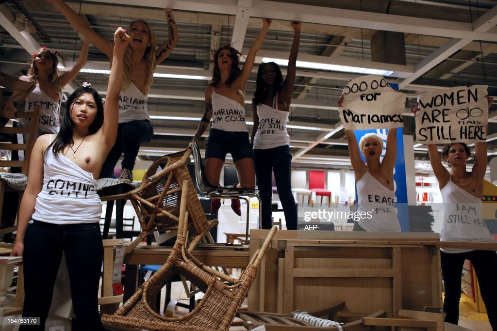 Femen activists demonstrate in the seating furniture ...