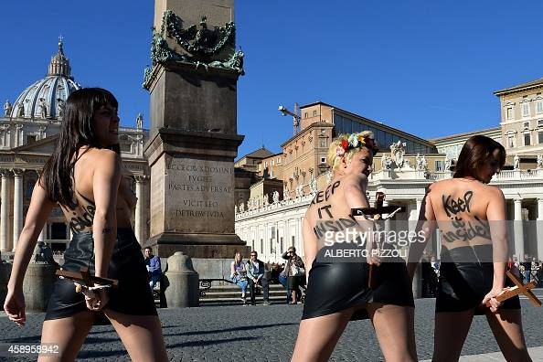 Femen activists protest in St.Peter's Square on November ...