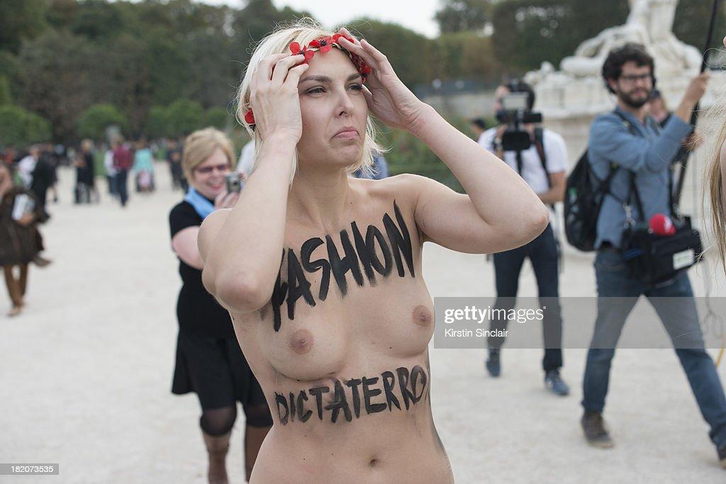 Femen protestor on day 3 of Paris Fashion Week Spring/Summer 2014, Paris September 26, 2013 in Paris, London.