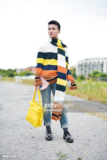 Femina China's fashion editor Austin Feng poses wearing Loewe jumper scarf and bag Dior pants and Nicholas Kirkwood shoes before the Gucci show...