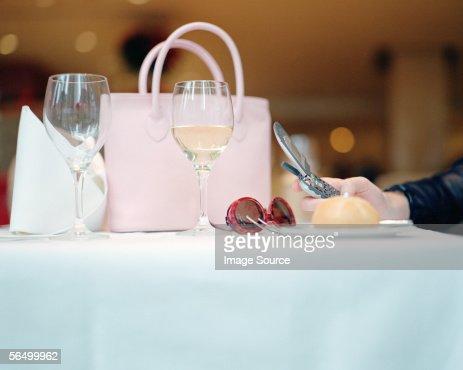 Feminine items on restaurant table