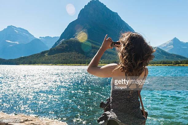 Feminine Woman Explores Scenic Glacier National Park with Camera Montana