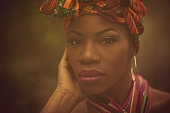 Femininity. African American woman in the park.