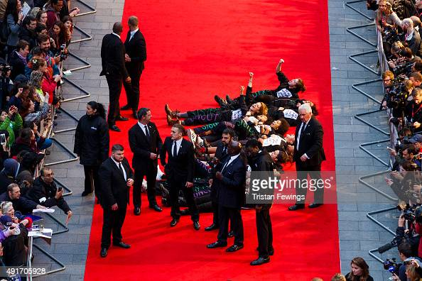 A feminist group Sisters Uncut protesting against cuts to support for victims of domestic violence occupy the red carpet during a protest at the...