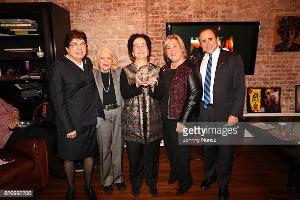 Feminist Press boardmember Barbara Rosen New York State Assembly Member Rebecca Seawright and Jim Owles Liberal Democratic Club president and gay...