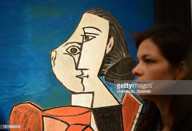 'Femme assise en costume rouge sur fond bleu' by Pablo Picasso is on display during a preview of Christie's Impressionist and Modern Art sales in New...