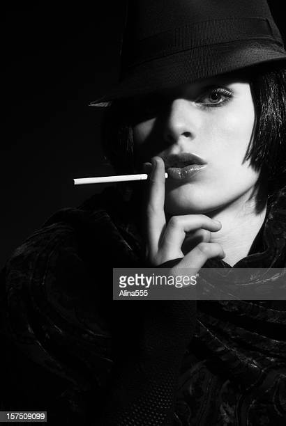 Femme Fatal: beautiful  woman wearing fedora on black background